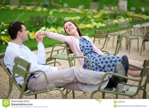 Romantic Couple Sitting On Chairs In Luxembourg Garden