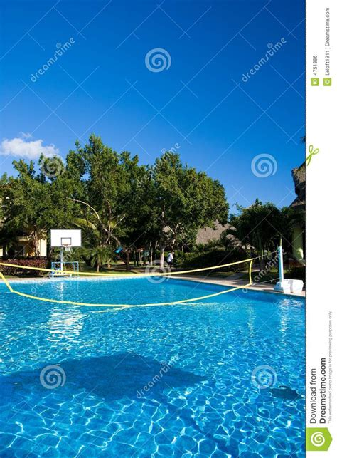 Swimming Pool With A Volleyball Net At A Resort In Royalty
