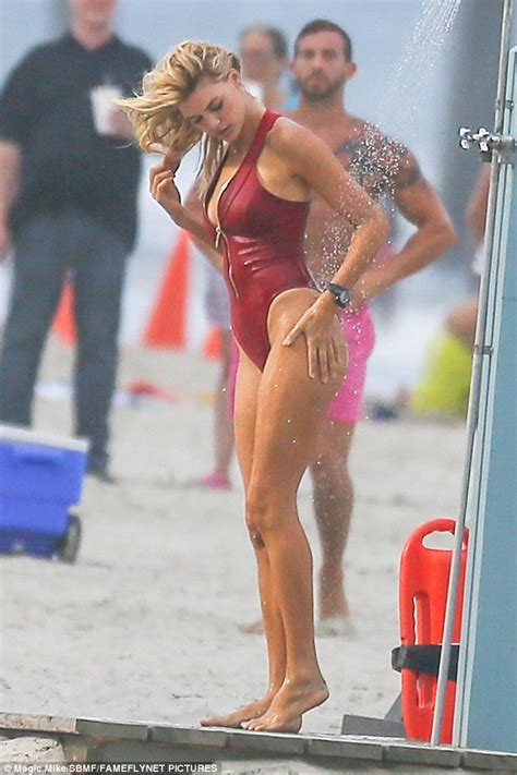 Kelly Rohrbach showers on beach after filming Baywatch